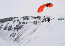 Gascoyne Inlet, Nunavut. 21 April 2012 – A search and rescue (SAR) technician parachutes into the drop zone at Gascoyne Inlet as part of SAR training during Operation NUNALIVUT 2012. (Photo by Corporal Jax Kennedy, Canadian Forces Combat Camera)
