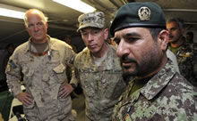 Panjwa'i District, Afghanistan. 23 May 2011 – Brigadier General Ahmad Habibi, Commander of the Afghan National Army's 1st Brigade of the 205th (Hero) Cops, is briefing General David H. Petraeus, Commander NATO International Security Assistance Force, and Brigadier General Dean Milner, Commander Task Force Afghanistan, at the Panjwa'i District Centre May 23 2011 in order to obtain an update on advances made in the district's security, development and governance. (Photo by: Corporal Tina Gillies, Image Tech, Roto 10)
