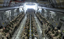 Kandahar, Afghanistan. 19 February 2009 – Canadian Forces personnel, completing their tour of duty, sit and await their departure aboard the CC-177 Globemaster III strategic transport aircraft at Kandahar Airfield, Afghanistan, 19 February 2009. (Photo by: MCpl Robert Bottrill, CF Combat Camera)