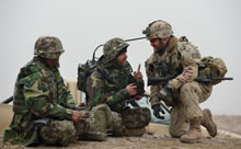 Pol-e-Charkhi, Afghanistan. 17 December 2012 – Captain André Parent (right) from 34 Combat Engineer Regiment in Westmount, Quebec, verifies the radio communications with an Afghan National Army soldier, Infantry 2/4/215, during a training scenario at the Consolidated Fielding Centre training area in Pol-e-Charkhi, Afghanistan on December 17, 2012. (Photo by: MCpl Marc-Andre Gaudreault, Canadian Forces Combat Camera