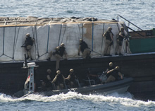 Arabian Sea, 9 October 2013 – Boarding party members of HMCS TORONTO board a suspect dhow during Operation ARTEMIS. (Photo by LS Dan Bard, Formation Imaging Services, Halifax)