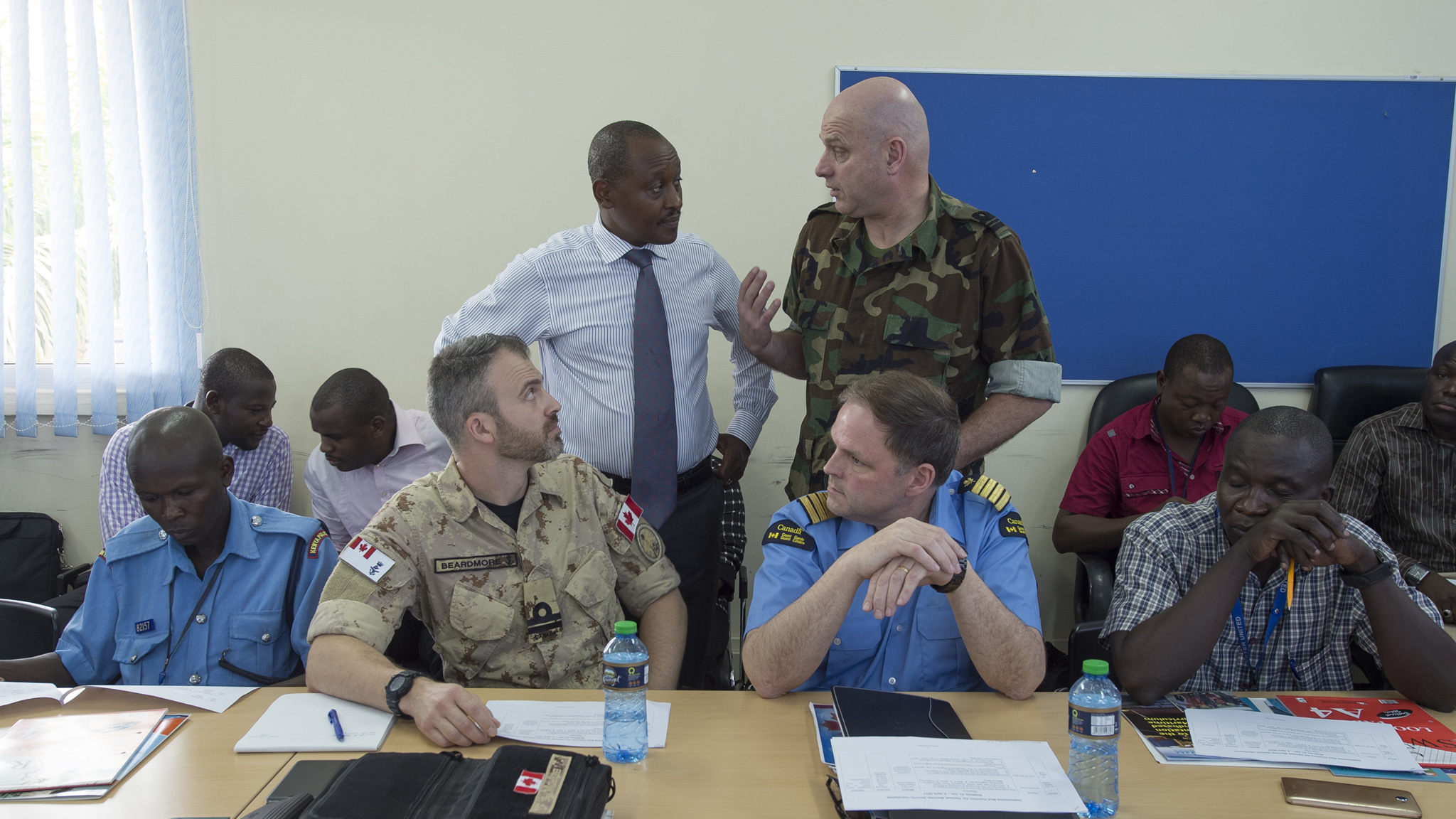 Mombasa, Kenya. January 31, 2017 – (Standing L-R) Kiruja Micheni, Project Officer for Counter Piracy Programme at International Maritime Organization,  Lieutenant Commander Derk Jan Hoving, Royal Netherlands Navy, (sitting L-R) Lieutenant (Navy) Christopher Beardmore, Canadian Armed Forces and Director of Programs, Brian Wootton, Canadian Coast Guard share ideas during the inter-agency cooperation seminar held at the Regional Maritime Rescue Coordination Centre in preparation for Exercise CUTLASS EXPRESS 17. (Photo: MCpl True-dee McCarthy, Canadian Forces Combat Camera)