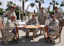The commanders of the Military Police of the Canadian and Hungarian contingents, as well as the Commander of the Multinational Force and Observers, sign the responsibility transfer documents on 23 March 2015 at the North camp of the MFO, in Sinai, Egypt. Photo credit: Sgt Tom Duval, US Army