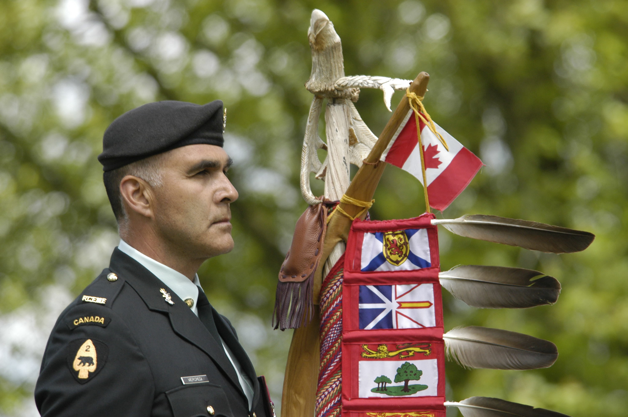 Master Warrant Officer Stanley Mercredi proudly carries the Eagle Staff during the commemoration of the 100th Anniversary of Beaumont-Hamel and the Battle of the Somme. (Photo: Captain Thomas Cameron Edelson, Canadian Joint Operations Command Public Affairs)