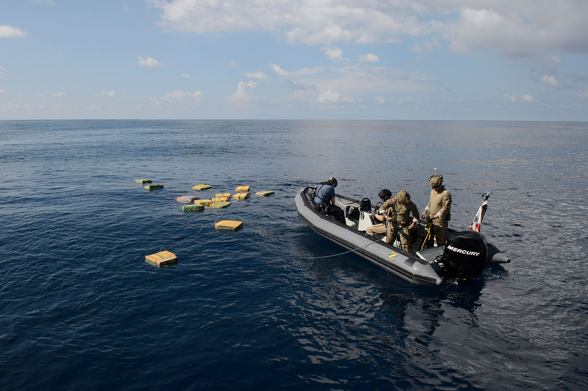 November 18, 2016. A Rigid Hulled Inflatable Boat from Her Majesty's Canadian Ship Edmonton with personnel from the United States Coast Guard recover bales of illicit drugs that were jettisoned into the Eastern Pacific Ocean during Operation CARIBBE. (Photo: MARPAC Imaging Services)