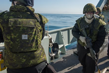 26 February 2016 – Sailors on Her Majesty's Canadian Ship (HMCS) EDMONTON defend the ship during a simulated Force Protection training exercise for Operation CARIBBE. (Photo: OP Caribbe, DND)
