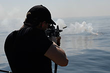 Eastern Pacific Ocean. November 8, 2016. A sailor on board Her Majesty's Canadian Ship EDMONTON fires the C8 service rifle during Operation CARIBBE. (Photo: MARPAC Imaging Services)