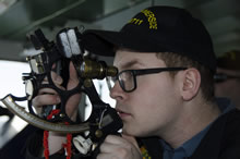 31 January 2016 – A bridge officer onboard HMCS Summerside is given a lesson on the use of a sextant on January 31, 2016, as the ship prepares for Operation CARIBBE. (Photo: Lt(N) Blake Patterson, PAO)