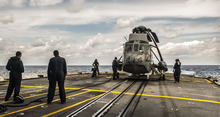 30 April 2015 - Her Majesty's Canadian Ship (HMCS) ATHABASKAN Air Detachment position the CH-124 Sea King Helicopter on the flight deck prior to take off while on Op CARIBBE. (Image By: Corporal Anthony Chand  )