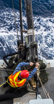 1 May 2015 – A member of Her Majesty's Canadian Ship (HMCS) ATHABASKAN prepares to receive the probe to begin fueling on the Starboard side of top part ship during a replenishment at sea (RAS) while on Op CARIBBE. (Image By: Corporal Anthony Chand )