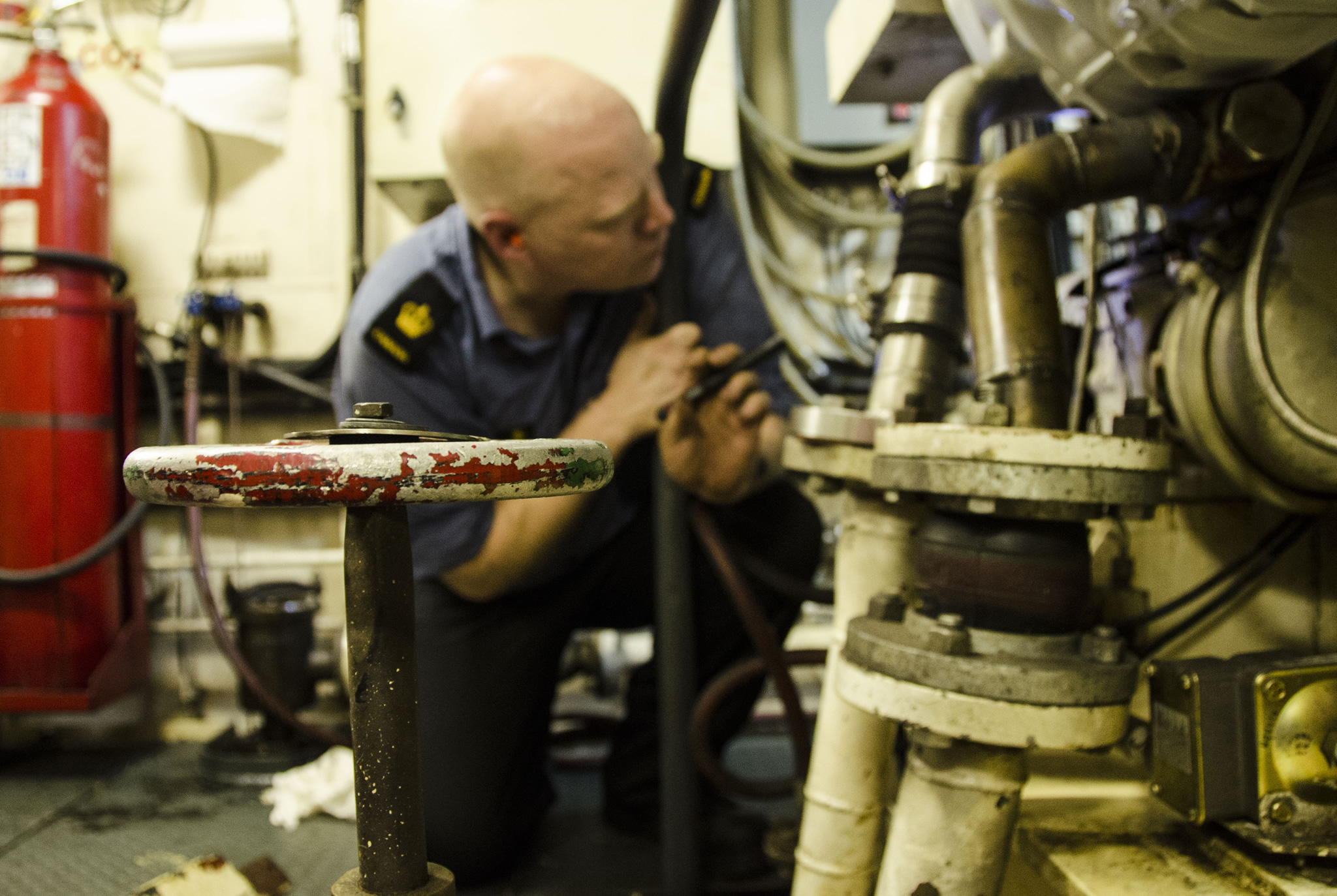The Main Propulsion Supervisor checks the diesel alternator onboard Her Majesty's Canadian Ship Saskatoon after a successful repair on March 10, 2017 during Operation CARIBBE. (Photo: Royal Canadian Navy Public Affairs)