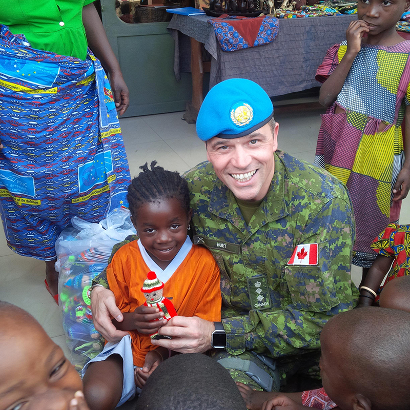 Goma, DRC. March 11, 2017 – Colonel Pierre Huet, commander of Operation CROCODILE, gives Izzy dolls to orphan children during a visit at Tulizeni Centre. (Photo: Op CROCODILE)