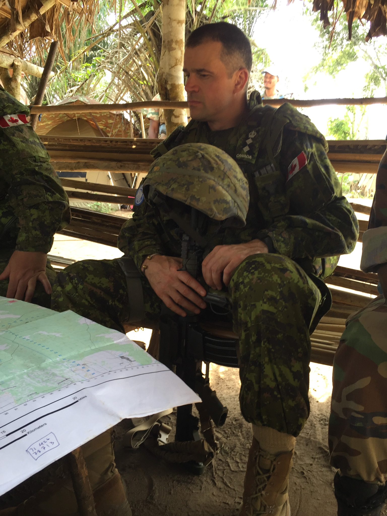 North Kivu, Democratic Republic of the Congo. July 2016 – Colonel Huet, the Task Force Commander of Operation CROCODILE, is back briefed on the plan to assault an objective as part of Op NYOKA.  Op NYOKA was an operation with the objective of disrupting the activities of Les Forces démocratiques de libération du Rwanda (FDLR) in the province of North Kivu. (Photo credit: MONUSCO)