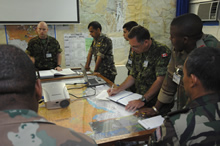 Kisangani, Democratic Republic of Congo. 6 June 2007 – Captain Stewart Maclean (center) takes notes during a briefing in the operations room at the MONUC (United Nations Observer Mission in the Democratic Republic of the Congo) Headquarters. (photo by: MCpl Robert Bottrill, Canadian Forces Combat Camera)