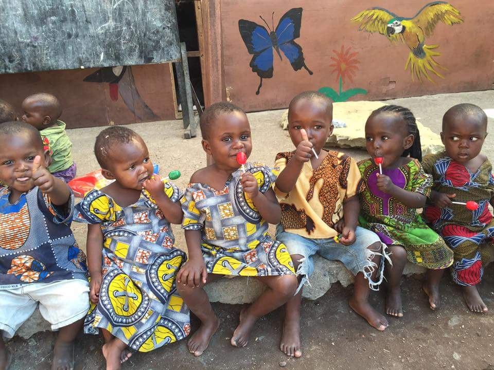 Children enjoy lollipops at Tulizeni Orphanage in Goma, Democratic Republic of Congo in November 2016. (Photo: Operation Crocodile CAF member)