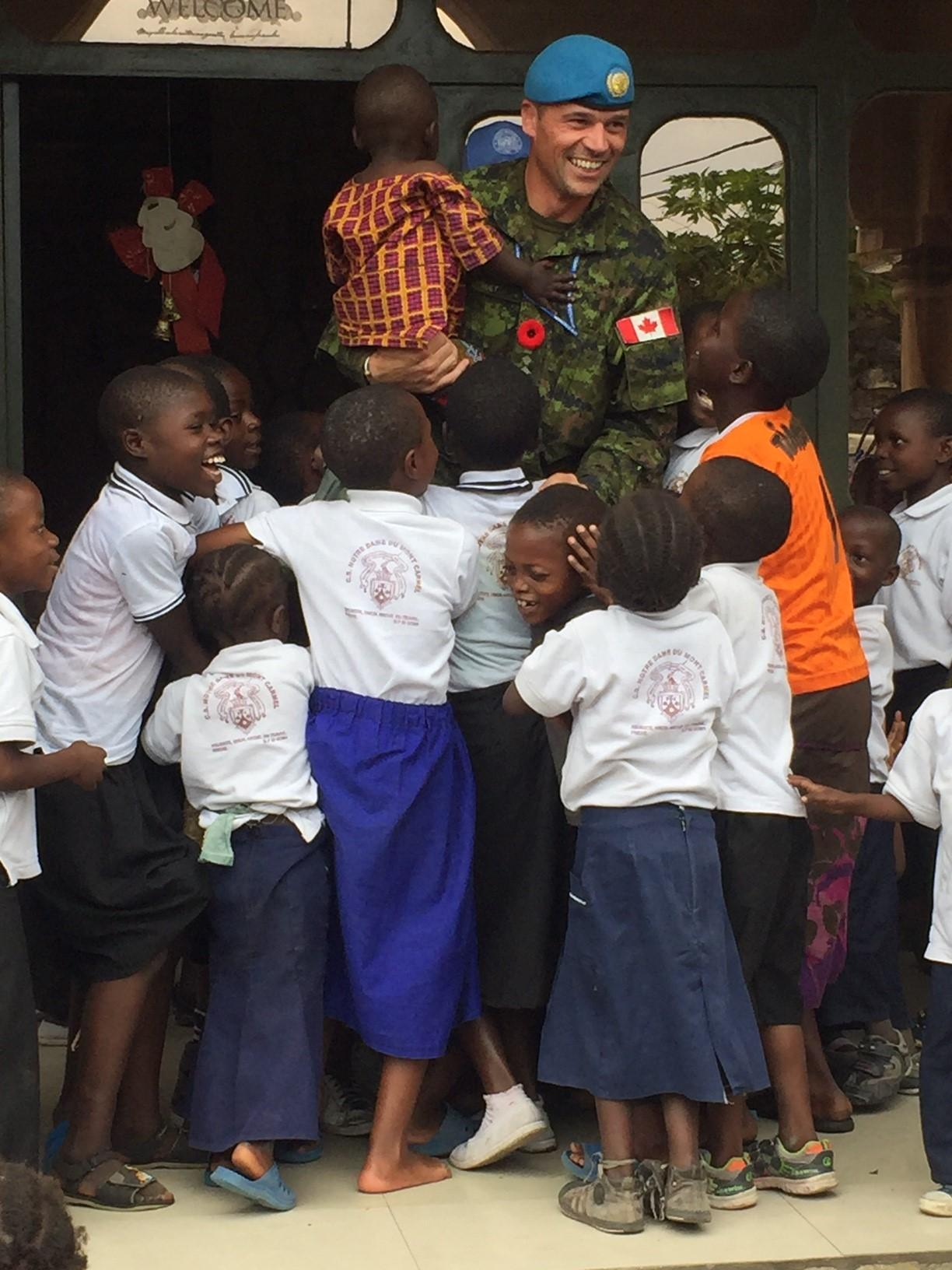 Children surround Colonel Pierre Huet at Tulizeni Orphanage in Goma, Democratic Republic of Congo in November 2016. (Photo: Operation Crocodile CAF member)