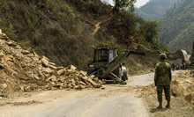 Camp Sumitra, Nepal. 16 May 2015 – A multipurpose engineer vehicle (MPEV) clears the road of a landslide blocking a portion of the Friendship Highway near camp Sumitra, Nepal. (Photo: MCpl Cynthia Wilkinson, Canadian Forces Joint Imagery Center )