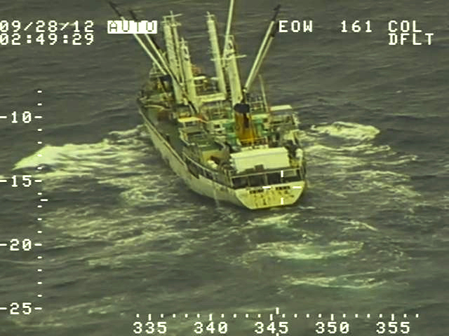 A fishing boat is seen from the onboard camera of an aircraft.