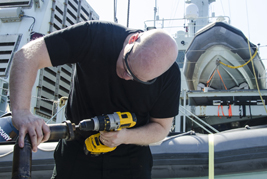 The Main Propulsion Supervisor checks the diesel alternator onboard Her Majesty's Canadian Ship Saskatoon after a successful repair on March 10, 2017 during Operation CARIBBE.