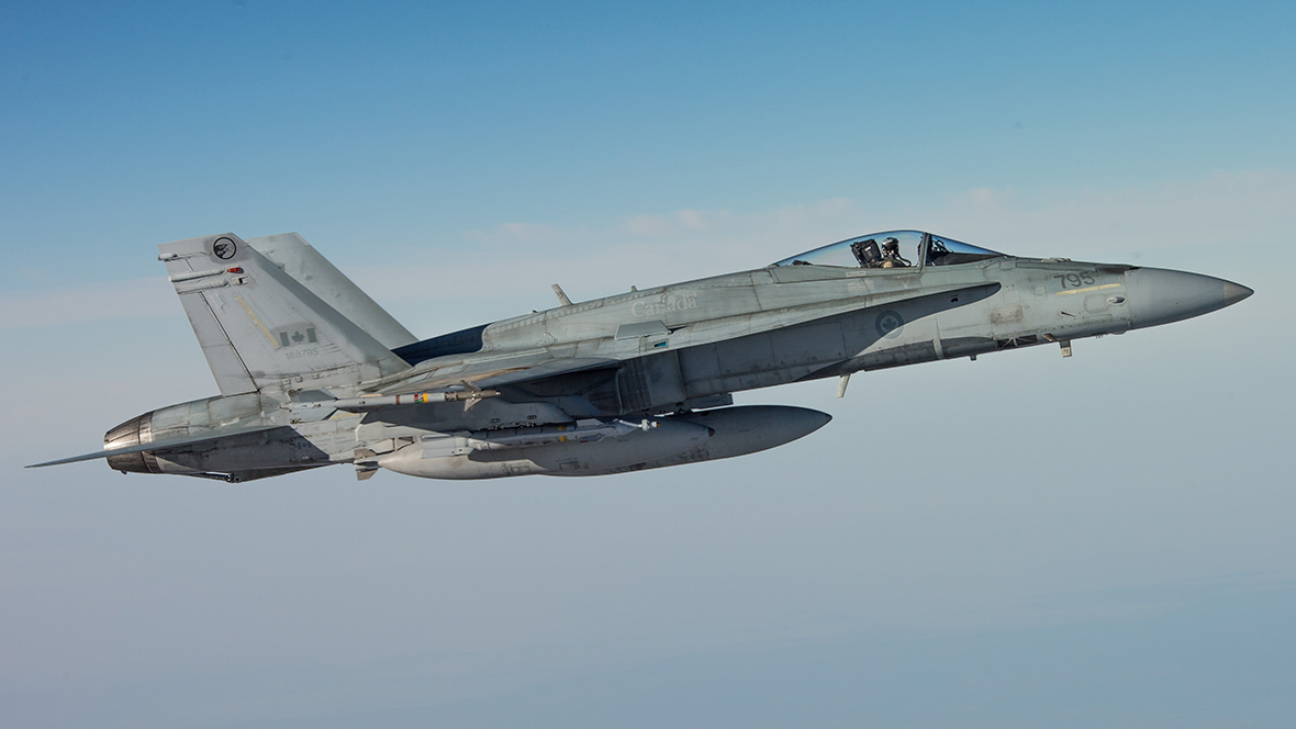 A CF-18 Hornet escorts a CC-150 Polaris after being refueled during Operation IMPACT on February 4, 2015.