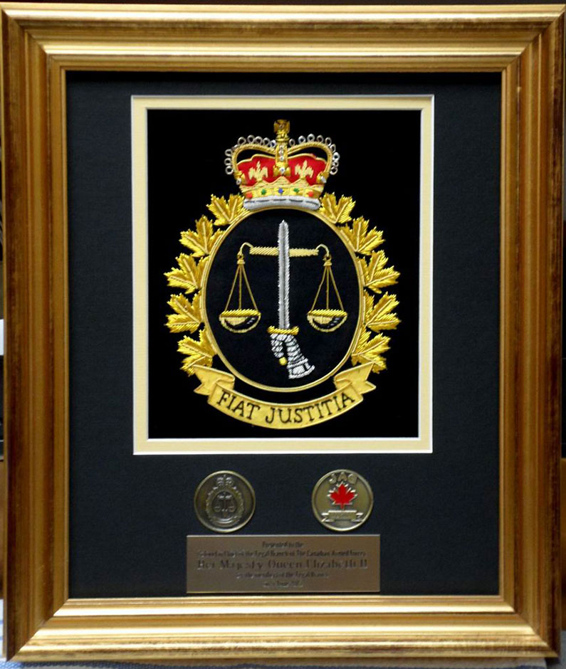 Legal Branch membership coin and a plaque of the Legal Branch Crest