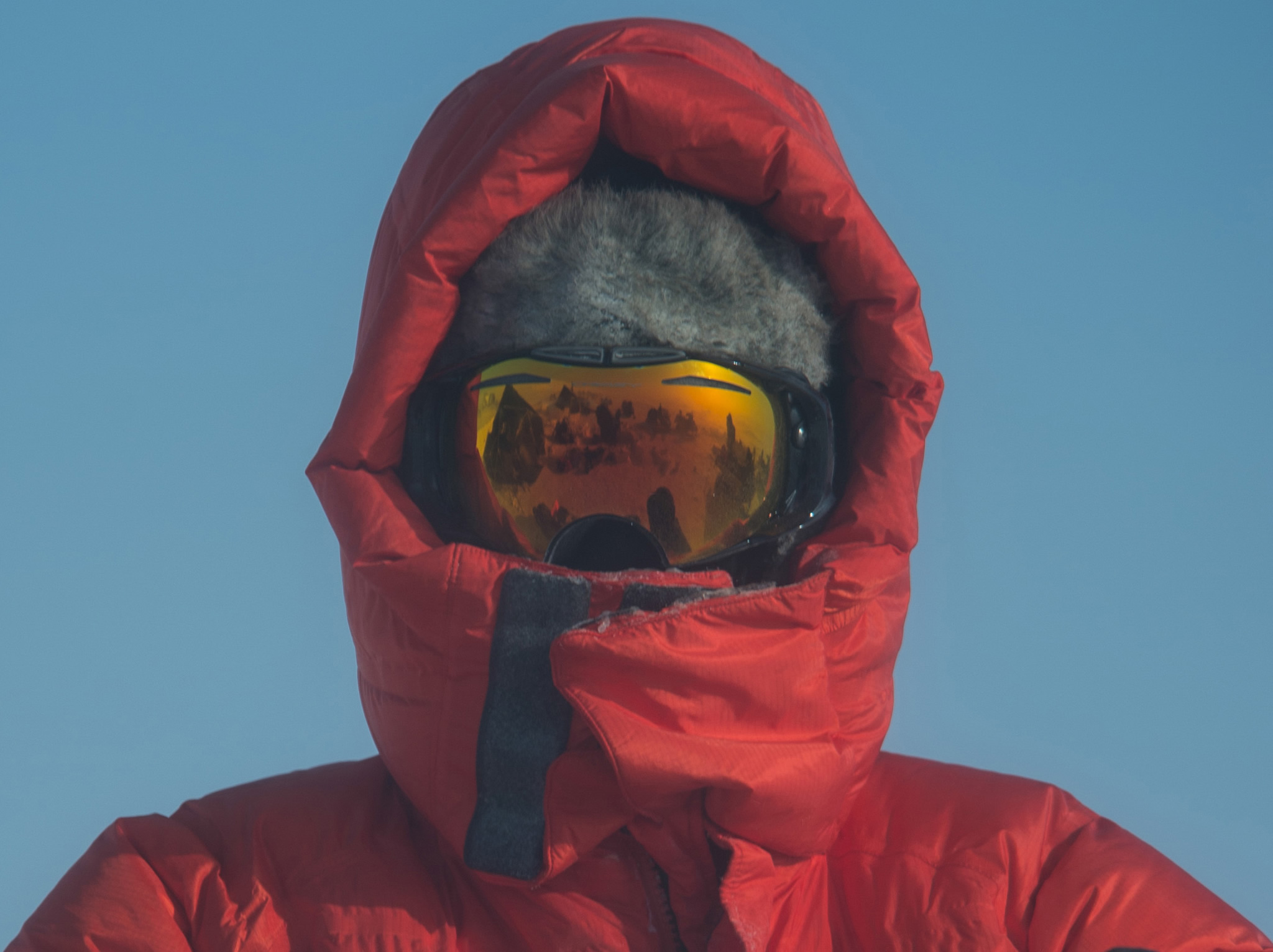 Man wearing hood and goggles