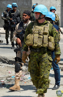 Cité Soleil, Port-au-Prince, Haiti. April 5, 2017 – Colonel Mark Gasparotto, the U.N. Stabilization Mission in Haiti military component Chief of Staff, and Major Stéphanie Moisan-Vallée, a Canadian military staff officer at Force Headquarters, accompanied soldiers with MINUSTAH's Brazilian Battalion, U.N. Police and Haitian National Police on a patrol. Regular patrols such as these have over the years brought peace to once-violent neighborhoods. (Photos courtesy of the Brazilian Battalion)