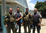 April 13, 2016. Les Cayes, Haiti. Major Carl MacKinlay (left) and Major Patrick Lanouette (second from right) meet with Canadian Police Officers upon their return from a Quick Reaction Force Exercise. (Photo: DND/MDN)