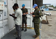 April 26, 2016. Port-au-Prince, Haiti. Capt Pierre Lessard (right) performs a verification of sea containers belonging to the Brazilian Contingent. (Photo: Captain Bruno Caldas Da Silva (Brazil)). (Photo: DND/MDN)