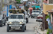 Port-au-Prince, Haiti. 10 September 2013 – United Nations Soldiers from 2nd Battalion, Royal 22e Regiment patrol streets during Operation HAMLET. (photo by: MCpl Marc-Andre Gaudreault, Canadian Forces Combat Camera)