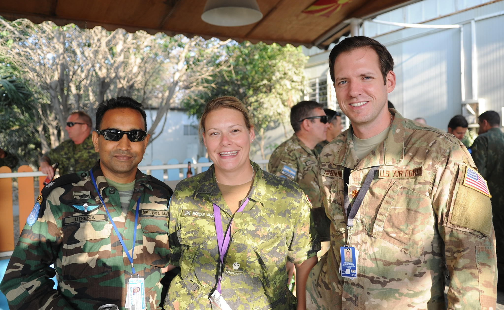 Port-au-Prince, Haiti. February 17, 2017 – Canadian Army Maj Stephanie Moisan-Vallée, a logistics officer in MINUSTAH, stands with two colleagues at Delta Camp, Port-au-Prince. (Photo by Sgt Faizal Kasan, MPIO)