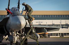 23 October 2014, Bagotville, Quebec – A pilot climbs aboard his CF-188 Hornet aircraft to take off from Canadian Forces Base (CFB) Bagotville to take part in Operation IMPACT. (Photo BN01-2014-0662-016 by LS Alex Roy, 3 Wing, Bagotville, Quebec)