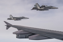 4 February 2015 - Two CF-18 Hornets escort a CC-150 Polaris after being refueled during Operation IMPACT on February 4, 2015. (Photo: Canadian Forces Combat Camera, DND)