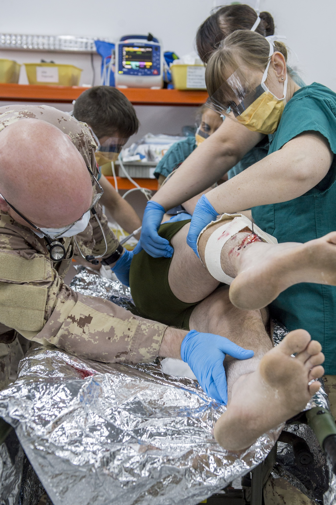 A Canadian Armed Forces physician assistant checks a simulated patient for hidden wounds during training at the Role 2 medical facility during Operation IMPACT in Northern Iraq on November 24, 2016. (Photo: Canadian Forces Combat Camera)
