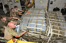 Albania. 7 September 2014 - Canadian Armed Forces members, United States Air Force members and Danish Forces members, load equipment onto a CC-177 Globemaster aircraft in Albania during Operation IMPACT on September 7, 2014. (Photo: MCpl Patrick Blanchard, Canadian Forces Combat Camera)