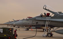 29 October 2014. Kuwait – A Royal Canadian Air Force pilot conducts verification checks on a CF-188 fighter jet on the flight line during Operation IMPACT. (Photo IS2014-5021-04 by Canadian Forces Combat Camera)