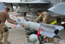 30 October 2014, Kuwait – Royal Canadian Air Force ground crew align a bomb as they mount munitions on a CF-188 Fighter jet prior to the first combat mission over Iraq in support of Operation IMPACT. (Photo IS2014-5022-07 by Canadian Forces Combat Camera)