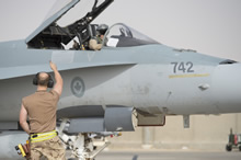 Camp Patrice Vincent, Kuwait. 11 June 2015 – A Royal Canadian Air Force technician gives a thumbs up to a CF-188 Hornet pilot during pre-flight checks at the flight line at Camp Patrice Vincent, Kuwait during Operation IMPACT. (Photo: OP Impact, DND)