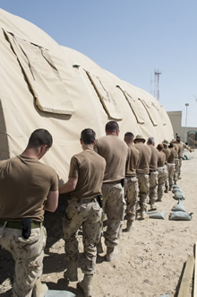 Camp Patrice Vincent, Kuwait. 28 June 2015 – Canadian Armed Forces members move a tent for camp setup at Camp Patrice Vincent, Kuwait during Operation IMPACT. (Photo: OP Impact, DND)