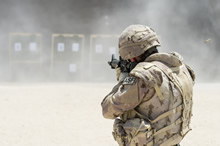 Camp Patrice Vincent, Kuwait. 20 August 2015 – A member of Air Task Force - Iraq Auxiliary Security Force (ASF) takes aim at a shooting range in Camp Patrice Vincent, Kuwait, during Operation IMPACT. (Photo: OP IMPACT, DND)