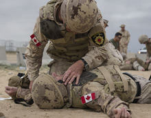 Kuwait. 27 Jan 2016 – Canadian Armed Forces Military Police and firefighters participate in a Combat First Aid Course given by the United States Marine Corps during Operation IMPACT.  (Photo: Op IMPACT, DND)