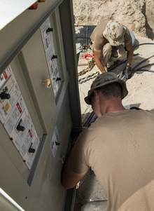 Kuwait. 9 March 2016. Canadian Armed Forces Electrical Distribution Technicians work on wiring at Camp Canada in Kuwait during on Operation IMPACT on March 9, 2016. (Photo:  Op IMPACT, DND)