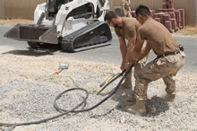 Construction Engineers pull lines out of the ground before building a gazebo at Camp Canada during Operation IMPACT in Kuwait on June 15, 2016. (Photo: Op Impact, DND)