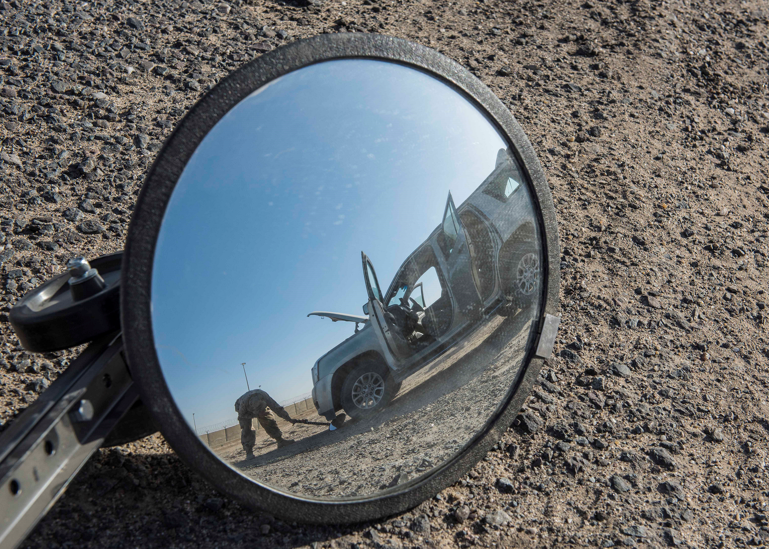 A Canadian Armed forces member of Joint Task force-Iraq searches a vehicle during Operation IMPACT at Camp Canada, Kuwait on December 15, 2016. (Photo: Op Impact, DND)
