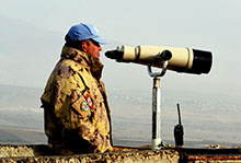 Mount Bental, Golan Heights. November 26, 2016 – Major Adrian Fyfe, Operation JADE Task Force Commander, observes the region through binoculars at a United Nations observation post. (Photo by Major Laine DenHollander, Netherlands)