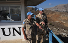 Golan Heights, 15 November 2008 – Captain Doug Levandier (left), Chief Observers Group Golan (OGG) and liaison-officer between the OGG Tiberias and Force Commander UN Disengagement Observer Force (UNDOF) and Capt Andrew Bailey, a UN Military Observer from Australia, survey their area of responsibility from Observation Post 51 in the United Nations Truce Supervision Organization (UNTSO) mission area in the Golan Heights. (photo by: MCpl Robert Bottrill, CF Combat Camera)