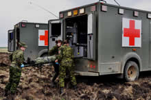 Wainwright, Alberta. 17 May 2013 - Members of 1 Canadian Field Hospital conduct a medical evacuation on a simulated aircraft crash victim during Exercise MAPLE RESOLVE 13 (JOINTEX) at Canadian Forces Base Wainwright, Alberta on May 17, 2013. (photo by Capt Christopher Daniel, Public Affairs Officer, 8 Wing Trenton)
