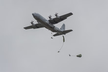 near Tancos Airfield, Portugal. 27 October 2015 – Portuguese Paratroopers jump from a Canadian CC-130J (Hercules) aircraft on a drop zone near Tancos Airfield, Portugal during JOINTEX 15 as part of NATO's Exercise Trident Juncture 15. (Photo: Master-Corporal Jonathan Barrette, Canadian Forces Combat Camera)