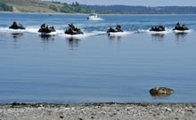 Near Canadian Forces Base Esquimalt, British Columbia. 9 May 2013 – Sailors with the Royal Canadian Navy navigate rigid hull inflatable boats carrying soldiers from the Royal 22e Régiment, to conduct a beach landing exercise during Exercise TRIDENT FURY 13. (Photo: Sgt Norm McLean, Canadian Forces Combat Camera)