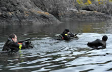 Near Canadian Forces Base Esquimalt, British Columbia. 16 May 2013 – Corporals Marc-André Lauzon, Marc Savoie, and Julien Dolci, members of the Royal 22e Régiment, swim out to open water to indicate a water landing zone for other members that will be parachuting down from a Royal Canadian Air Force CC-130 Hercules aircraft near Canadian Forces Base Esquimalt, British Columbia during Exercise TRIDENT FURY 13 (JOINTEX). (Photo: Sgt Norm McLean, Canadian Forces Combat Camera)